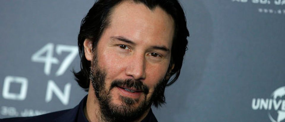 """Actor Reeves poses during photocall to promote film """"47 Ronin"""" in Munich"""