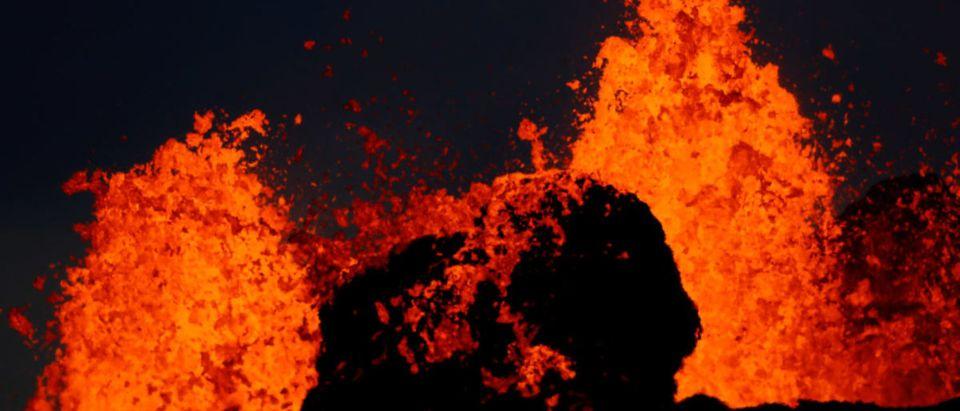 Lava from the Kilauea volcano shoots out of a fissure, in the Leilani Estates near Pahoa, Hawaii