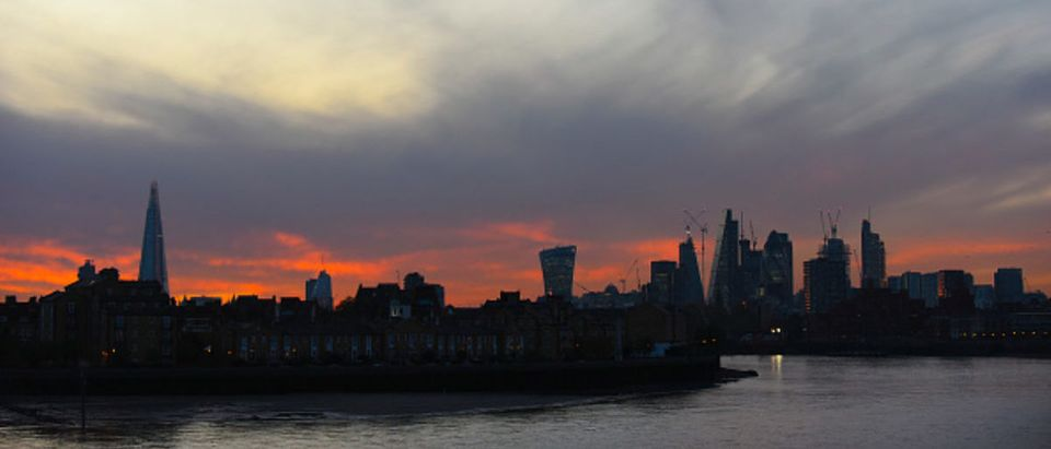 The skyline of the City of London is seen as the sun sets making the sky colourful, London on November 1, 2017. (Photo by Alberto Pezzali/NurPhoto via Getty Images)