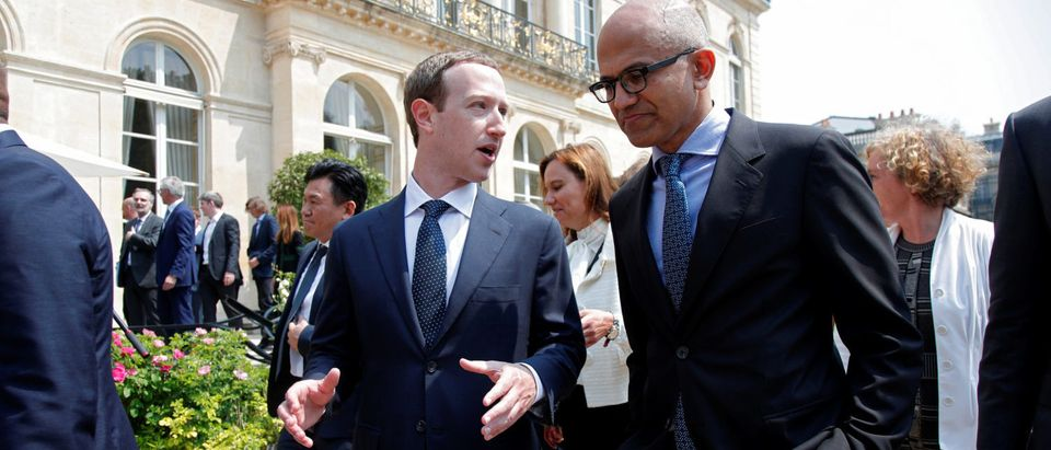 "Facebook's CEO Mark Zuckerberg and Microsoft's CEO Satya Nadella leave after a family picture with guests of the ""Tech for Good"" Summit at the Elysee Palace in Paris"