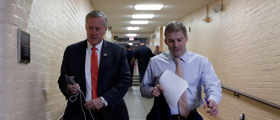 Rep. Mark Meadows (R-NC), left, and Rep. Jim Jordan (R-OH), arrive for a Republican conference meeting at the U.S. Capitol in Washington