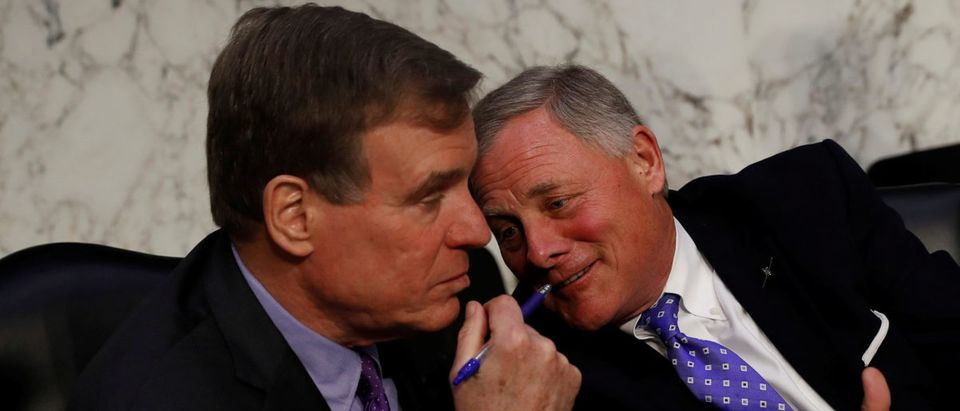 Sen. Mark Warner (D-VA) and Sen. Richard Burr (R-NC) speak following CIA Director nominee Gina Haspel testifying before the Senate Intelligence Committee on Capitol Hill in Washington