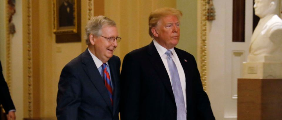 U.S. President Donald Trump arrives with Senate Majority Leader Mitch McConnell for the Senate Republicans policy luncheon on Capitol Hill in Washington, U.S., May 15, 2018. REUTERS/Kevin Lamarque
