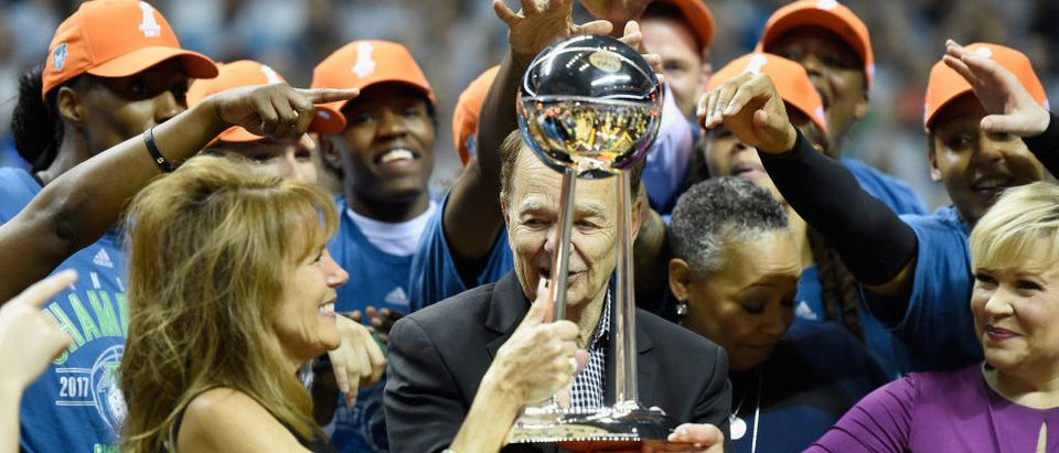 Owner Glen Taylor of the Minnesota Lynx and wife, Becky, are handed the Championship Trophy after defeating the against the Los Angeles Sparks in Game Five of the WNBA Finals on October 4, 2017 at Williams in Minneapolis, Minnesota. (Photo by Hannah Foslien/Getty Images)