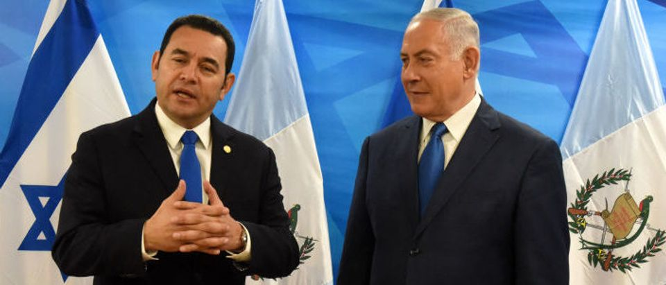 Guatemalan President Jimmy Morales (L) speaks as he is received by Israeli Prime Minister Benjamin Netanyahu at the latter's office in Jerusalem on May 16, 2018. (Photo: DEBBIE HILL/AFP/Getty Images)