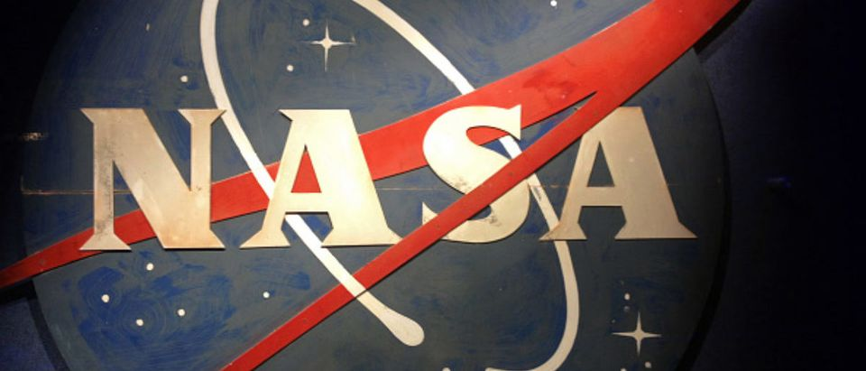 An old NASA logo hangs on a wall at the Kennedy Space Center Visitor Complex in a 2016 file image. (Marjie Lambert/Miami Herald/TNS via Getty Images) | 4chan Trolls NASA