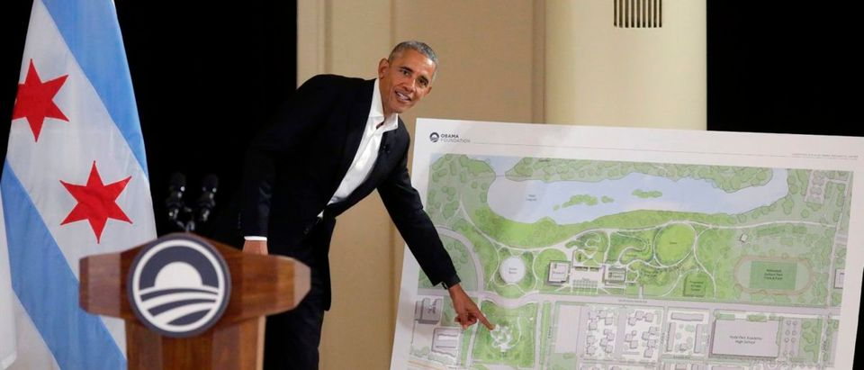 Former US President Barack Obama points to a location on a map that shows the design of the Obama Presidential Center as he speaks about the progress of the center during a community event at the South Shore Cultural Center on May 3, 2017 in Chicago, Illinois. The Obama Presidential Center will be constructed in Jackson Park on Chicago's South Side Woodlawn neighborhood. / AFP PHOTO / Joshua LOTT (Photo credit should read JOSHUA LOTT/AFP/Getty Images) | Obama Center Bait And Switch