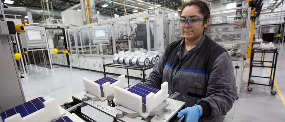A production operator Diana Correa loads cells into a machine at the SolarWorld solar panel factory in Hillsboro, Oregon, U.S, January 15, 2018. Picture taken January 15, 2018. REUTERS/Natalie Behring | Solar Company Opens After Trump Tariffs
