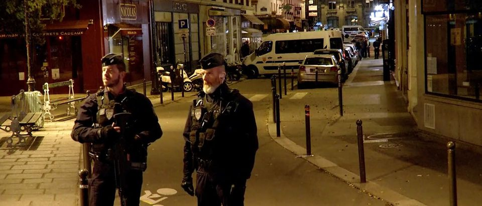 Police guard the scene of a knife attack in Paris
