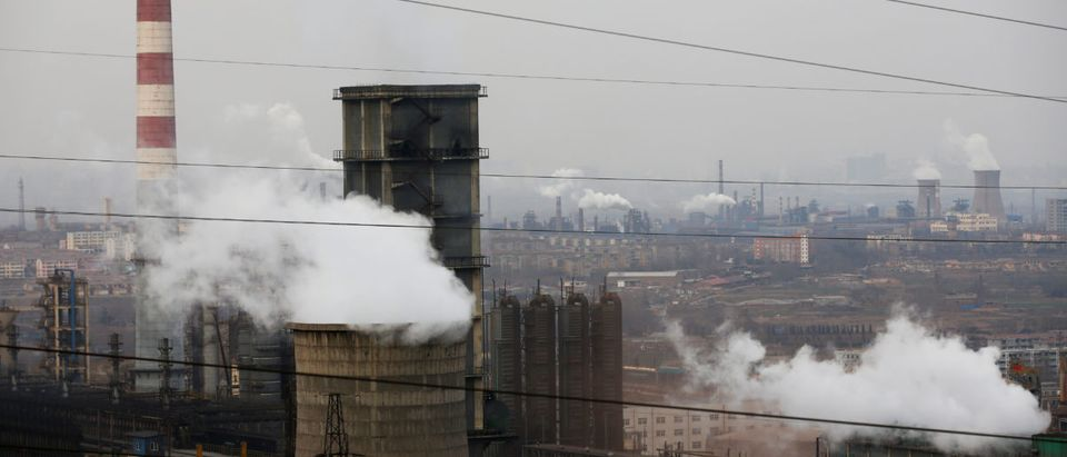 Cooling towers emit steam and chimneys billow in an industrial zone in Wu'an, Hebei province, China, February 20, 2017. Picture taken February 20, 2017. REUTERS/Thomas Peter | Many Nuclear Plants Are Losing Money