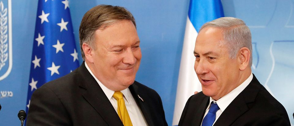 Israeli Prime Minister Benjamin Netanyahu shakes hands with U.S. Secretary of State Mike Pompeo during a meeting at the Ministry of Defence in Tel Aviv
