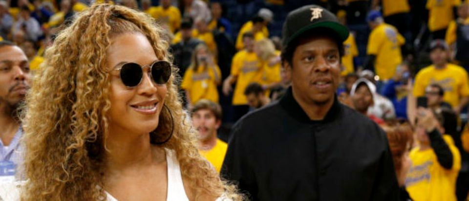 Apr 28, 2018; Oakland, CA, USA; American recording artists Beyonce and Jay-Z leave the court at the end of the Golden State Warriors and New Orleans Pelicans game, in game one of the second round of the 2018 NBA Playoffs at Oracle Arena. Mandatory Credit: Cary Edmondson-USA TODAY Sports - 10810648