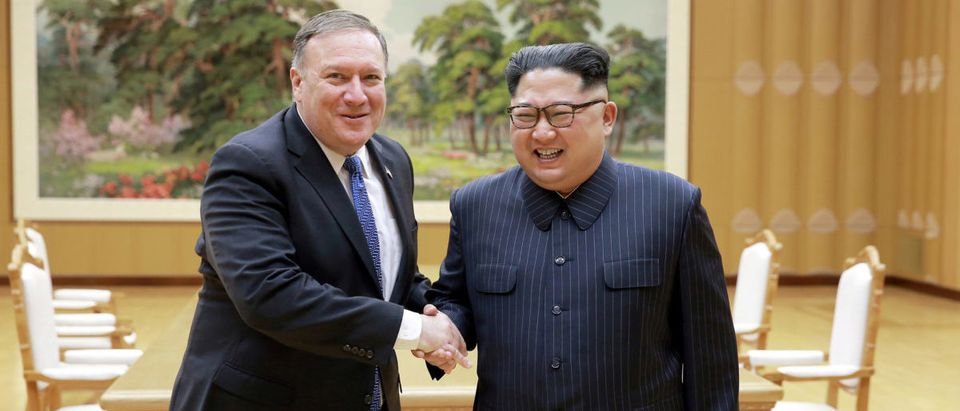 North Korean leader Kim Jong Un shakes hands with U.S. Secretary of State Mike Pompeo