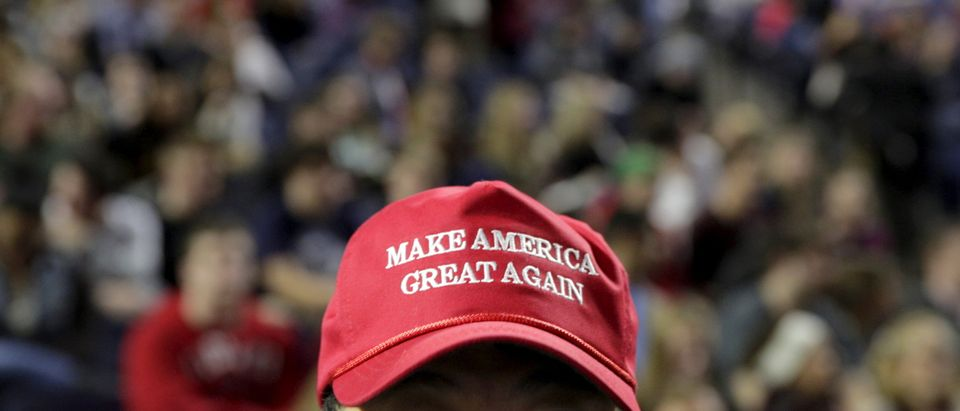 "A supporter of US Republican presidential candidate Donald Trump wears a ""Make America Great Again"" cap before his speech at Liberty University in Lynchburg, Virginia."