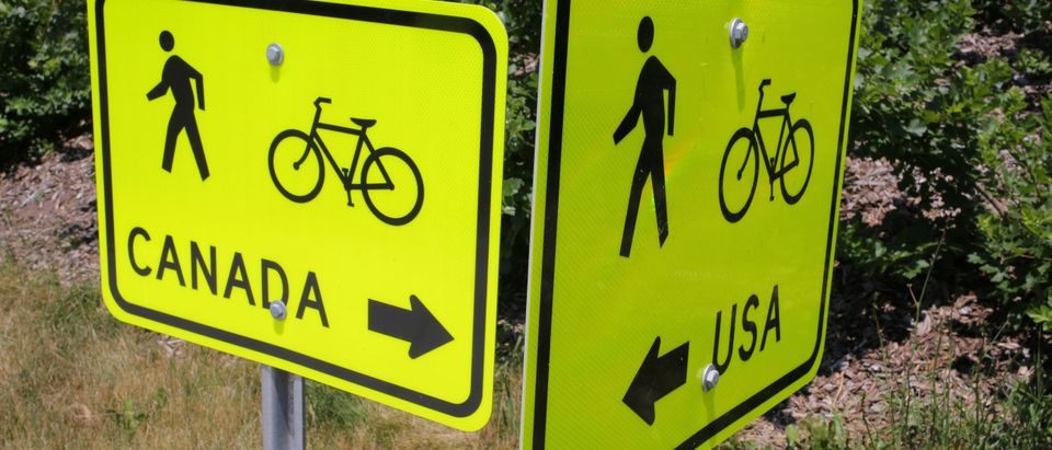 A sign pointing to a pedestrian and cycle route is seen at the Peace Bridge in Fort Erie