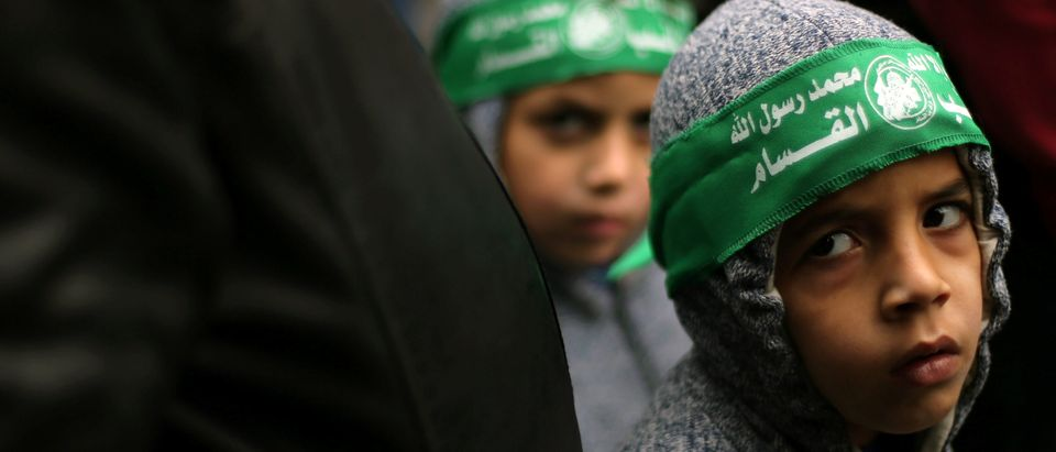 Palestinian children wearing Hamas headbands take part in a rally against U.S. President Donald Trump's decision to recognize Jerusalem as the capital of Israel, in Khan Younis the southern Gaza Strip