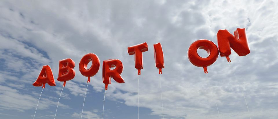 Red abortion balloons in the sky