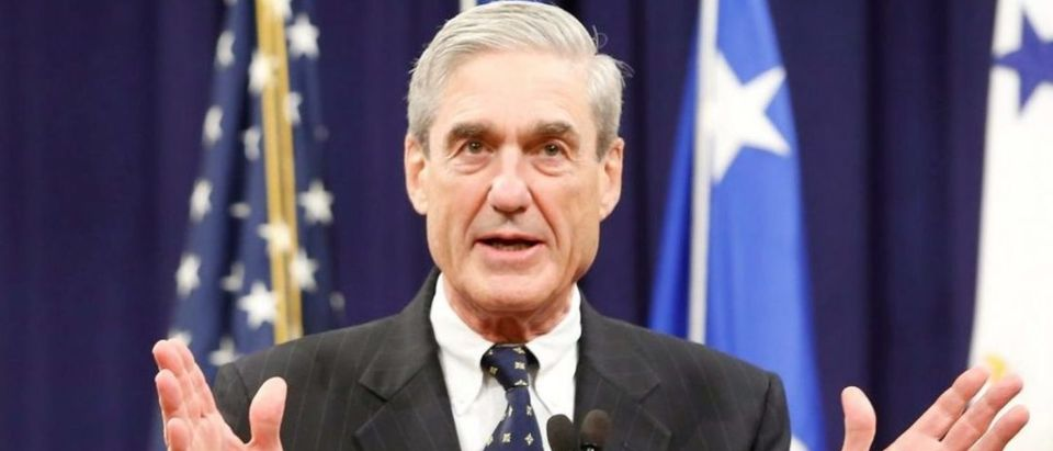 FILE PHOTO - Robert Mueller reacts to applause from the audience during his farewell ceremony at the Justice Department in Washington