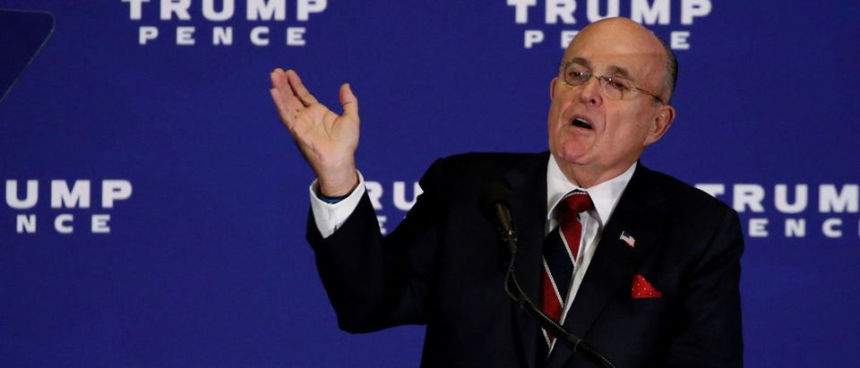 FILE PHOTO: Giuliani introduces Trump to deliver remarks at a campaign event in Gettysburg, Pennsylvania