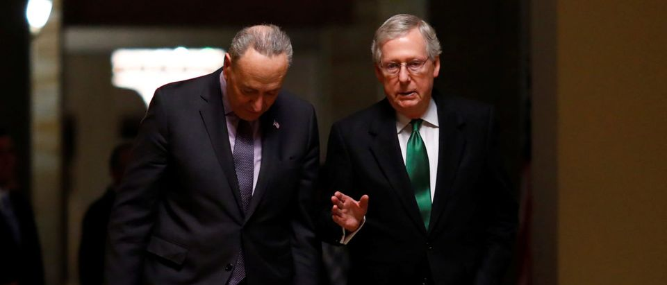 Schumer (D-NY) and McConnell (R-KY) walk to the Senate chamber on Capitol Hill in Washington