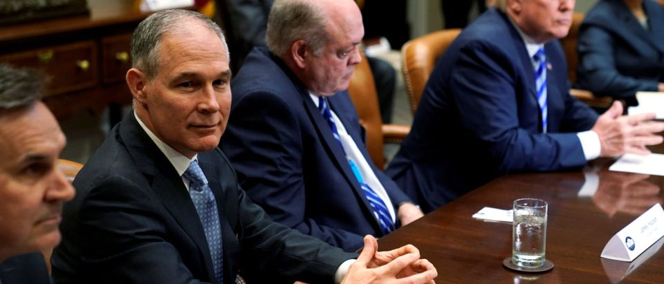 Environmental Protection Agency (EPA) Administrator Scott Pruitt (2nd L) attends as U.S. President Donald Trump meets with chief executives of major U.S. and foreign automakers at the White House in Washington, U.S. May 11, 2018. REUTERS/Jonathan Ernst | EPA Memo Released For The First Time