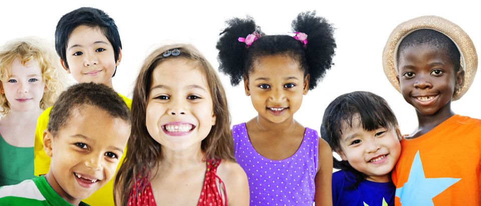 A group of smiling children. (Shutterstock/Rawpixel.com)