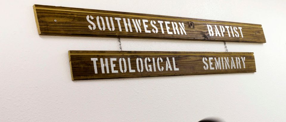 An offender walks past the Southwestern Baptist Theological Seminary sign hanging on a wall inside the Darrington Unit of the Texas Department of Criminal Justice men's prison in Rosharon, Texas August 12, 2014. The Southwestern Baptist Theological Seminary, a private college based in Fort Worth, Texas, began its bachelor of science in biblical studies program at Darrington, south of Houston, about three years ago. To be accepted, an offender has to be at least 10 years from the possibility of parole, have a good behavior record and the appropriate academic credentials to enroll in a college course. The program, which is largely paid for by charitable contributions from the Heart of Texas Foundation, has more than 150 prisoners enrolled and plans to send its graduates as field ministers to other units who want the bible college alumni for peer counseling and spiritual guidance. The first degrees are expected to be conferred next year. Picture taken August 12, 2014. To match Feature USA-TEXAS/PRISON REUTERS/Adrees Latif