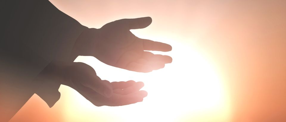 Spiritual healing, hands outstretched