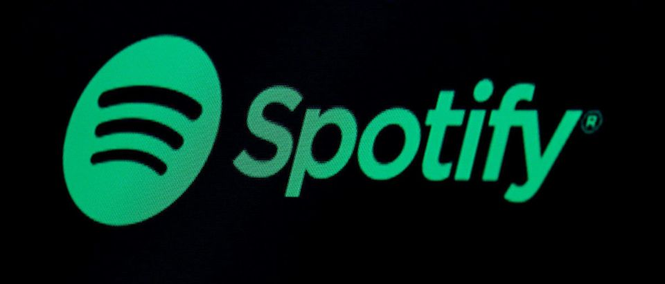 The Spotify logo is displayed on a screen on the floor of the New York Stock Exchange (NYSE) in New York, U.S., May 3, 2018. REUTERS/Brendan McDermid | SPLC Policing Spotify For Hate Content