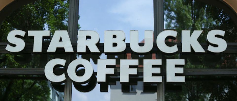 The logo of American coffee company and coffeehouse chain Starbucks is seen in Munich. (Photo by Alexander Pohl/NurPhoto via Getty Images)