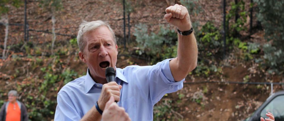 Political and climate activist Tom Steyer speaks while taking part in a protest against U.S. President Donald Trump and Republican congressman Darrell Issa (R-Vista) outside Issa's office in Vista