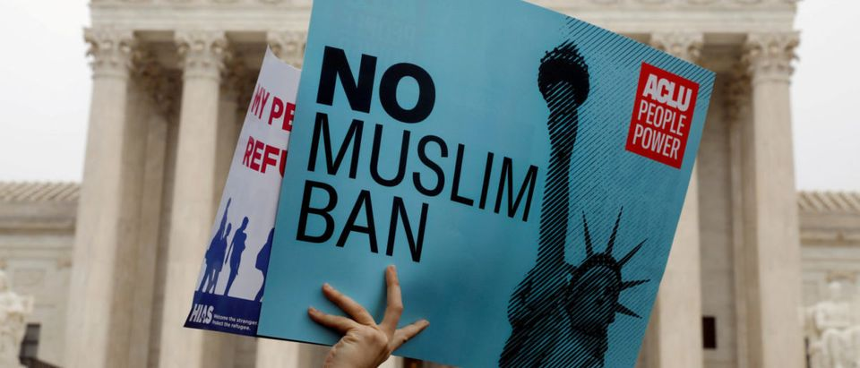 FILE PHOTO: Protesters rally outside the U.S. Supreme Court, while the court justices consider case regarding presidential powers as it weighs the legality of President Donald Trump's latest travel ban targeting people from Muslim-majority countries, in Washington, DC, U.S., April 25, 2018. REUTERS/Yuri Gripas | Disabled Yemeni Girl Reached U.S.
