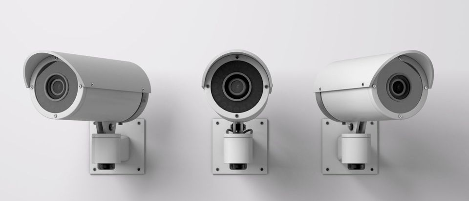 Surveillance cameras are pointing in different directions. [Shutterstock - Ink Drop]