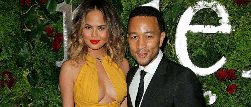 Model Christine Teigen (L) and singer/songwriter John Legend attend the Nielsen Pre-GRAMMY Party at Mondrian Los Angeles on January 25, 2014 in West Hollywood, California. (Photo by Joe Scarnici/Getty Images for MAC Presents)