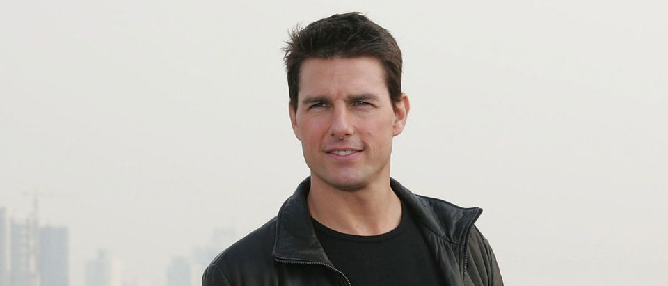 Actor Tom Cruise poses for the press at the end of a news conference promoting his new film Mission Impossible III atop Shanghai's historic Bund 18 building on November 30, 2005 in Shanghai, China. (Photo by China Photos/Getty Images)