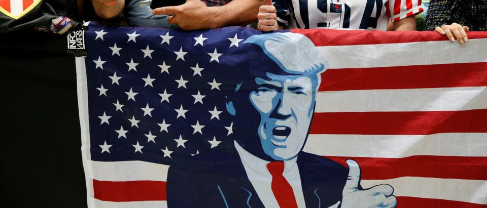 Supporters of U.S. President Donald Trump cheer as they wait for him to appear at a rally with supporters at North Side middle school in Elkhart, Indiana, U.S.