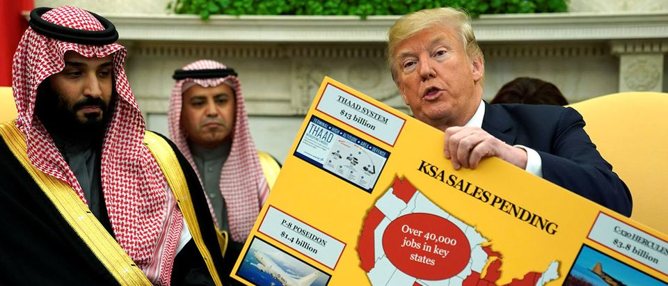 U.S. President Donald Trump holds a chart of military hardware sales as he welcomes Saudi Arabia's Crown Prince Mohammed bin Salman in the Oval Office at the White House in Washington, U.S. March 20, 2018. REUTERS/Jonathan Ernst | Trump's New Mideast Alliance Emerges