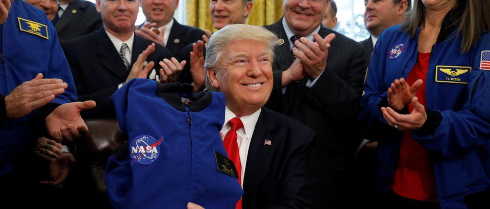 Trump signs NASA act at the White House in Washington