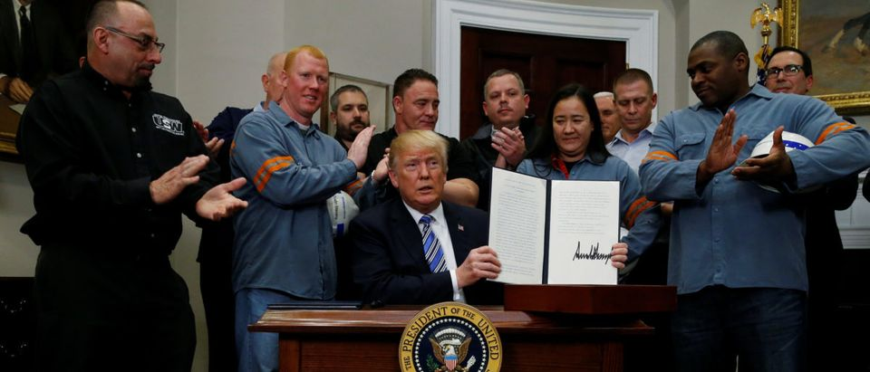 U.S. President Donald Trump is after signing a proclamation to establish tariffs on imports of steel and aluminum at the White House in Washington, U.S., March 8, 2018. REUTERS/Leah Millis TPX IMAGES OF THE DAY | Is US Too Reliant On Foreign Minerals?