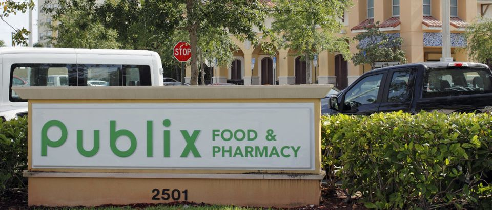 Two Publix Food & Pharmacy signs with a Publix grocery store. Publix grocery signs and supermarket on a sunny day -- ShutterStock -- Serenethos | Publix Faces Boycott For Supporting GOP