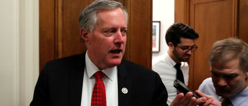 U.S. Rep. Mark Meadows and Rep. Jim Jordan (R), leaders in the House Freedom Caucus, talk to reporters as they walk between meetings at the U.S. Capitol in Washington, U.S., Jan. 18, 2018. REUTERS/Jonathan Ernst