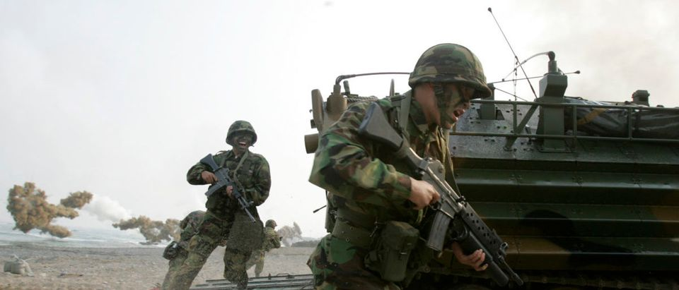 South Korean marines conduct a joint landing operation involving U.S. and South Korean troops to prepare for possible aggression by North Korea, which the South remains technically at war with since the end of the Korean War in 1953, on a seashore in Pohang, about 370 km (231 miles) southeast of Seoul, November 14, 2007. REUTERS/Lee Jae-Won