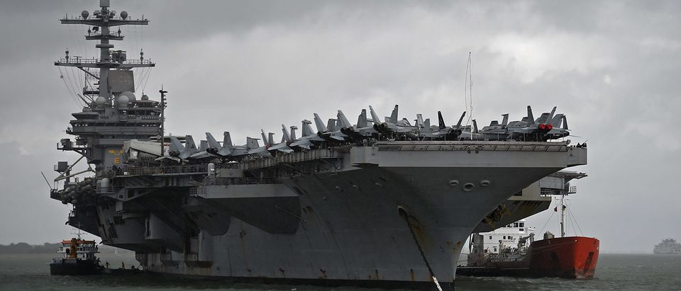 The USS George H.W. Bush aircraft carrier is seen anchored off Stokes Bay in the Solent, Britain, July 27, 2017. REUTERS/Hannah McKay   Navy Revives Second Fleet