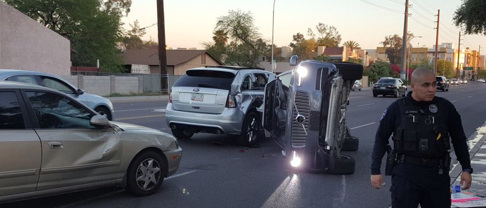 A self-driven Volvo SUV owned and operated by Uber Technologies Inc. is flipped on its side after a collision in Tempe