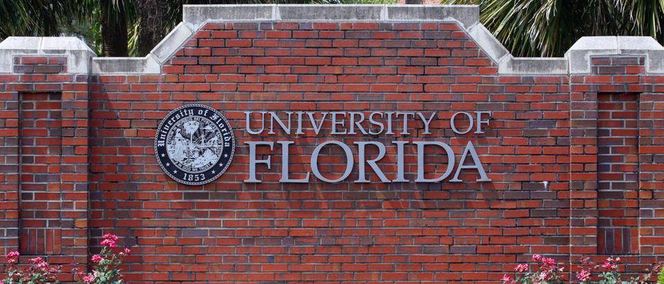 University of Florida wall (Shutterstock/Katherine Welles) | UF Usher Wrestles Graduates Off Stage