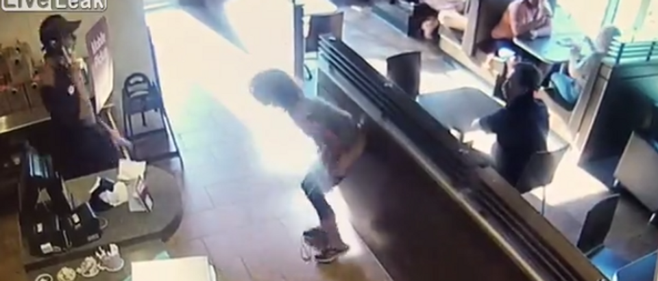 Woman at Tim Hortons (screengrab via LiveLeak)