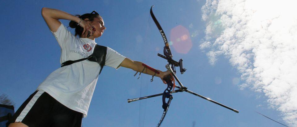 Olympic hopeful and member of the U.S. archery team Gibilaro practises in Branford