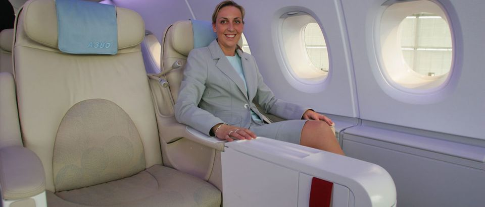 A woman sits in business class for flight. (Photo: Andreas Rentz/Getty Images) | Fmr DHSer Dinged For Nepotism, Travel
