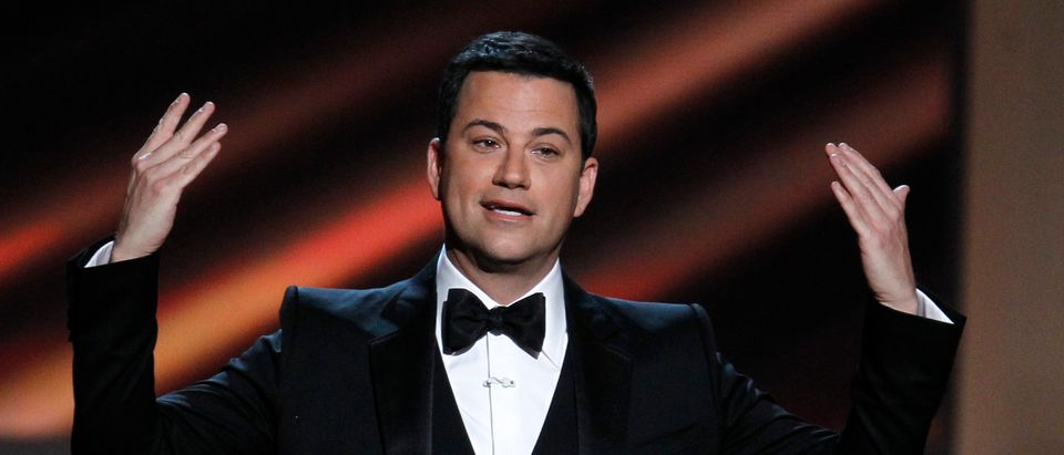 Host Jimmy Kimmel opens the show at the 64th Primetime Emmy Awards in Los Angeles, September 23, 2012. REUTERS/Lucy Nicholson (UNITED STATES - Tags: ENTERTAINMENT) (EMMYS-SHOW) - TB3E89O013QEN