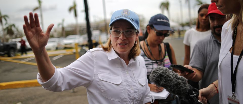 Mayor of San Juan Carmen Yulin Cruz talks with journalists outside the government center at the Roberto Clemente Coliseum days after Hurricane Maria, in San Juan